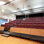 foldaway tiered seating to school hall at Portsmouth Grammar School New Science Block