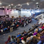Congregation listening to the pastor during Sunday Service inside the large modern Kings Community Church