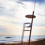 Unmanned lifeguard tower on deserted beach in winter