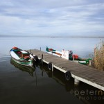 Picturesque view of wooden jetty on Lake Albufera with boats awaiting customers