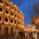 Exterior of the Bullring Plaza de Toros Valencia lit up on a wet rainy night