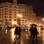 People under umbrellas on a rainy night on the streets of Valencia in Spain