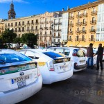 Taxis parked waiting for business in the Plaza de la Reina Valencia Spain