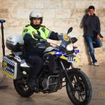 Spanish traffic police motorcyclist in pedestrian area of Valencia