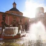 Turia Fountain Plaza De La Virgen La Seu with the Basilica de la Virgen de los Desamparados and cathedral in Valencia Spain