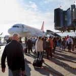 Passengers walking to board Easyjet aircraft under jet bridge
