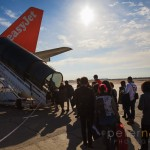 Passengers using the rear aircraft stairs to board an Easyjet aircraft with sunburst
