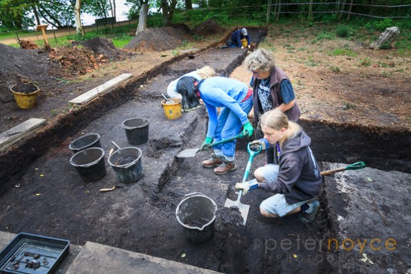 Archaeologists working on a Bronze Age excavation trench