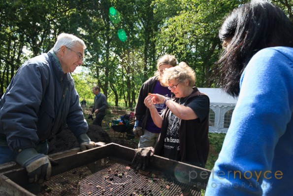 Professional archaeologist explaining a find to lay archaeologists on a dig