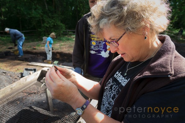 Professional archaeologist examining a find on a Bronze age dig